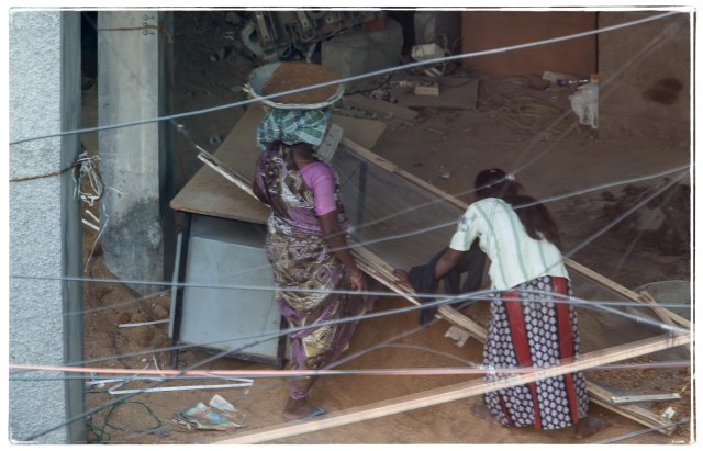 Women sieving and carrying sand